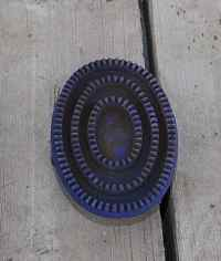 Rubber curry comb, great for getting rid of dirt and loose horsehair.